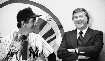 New York Yankees owner George Steinbrenner in 1978 shares a laugh with Billy Martin as they answer questions at a news conference after the Old Timers Day game at Yankee Stadium. The two had a tempestuous relationship, with Mr. Steinbrenner hiring and firing Mr. Martin five times as manager of the American League's most celebrated team. (Associated Press)