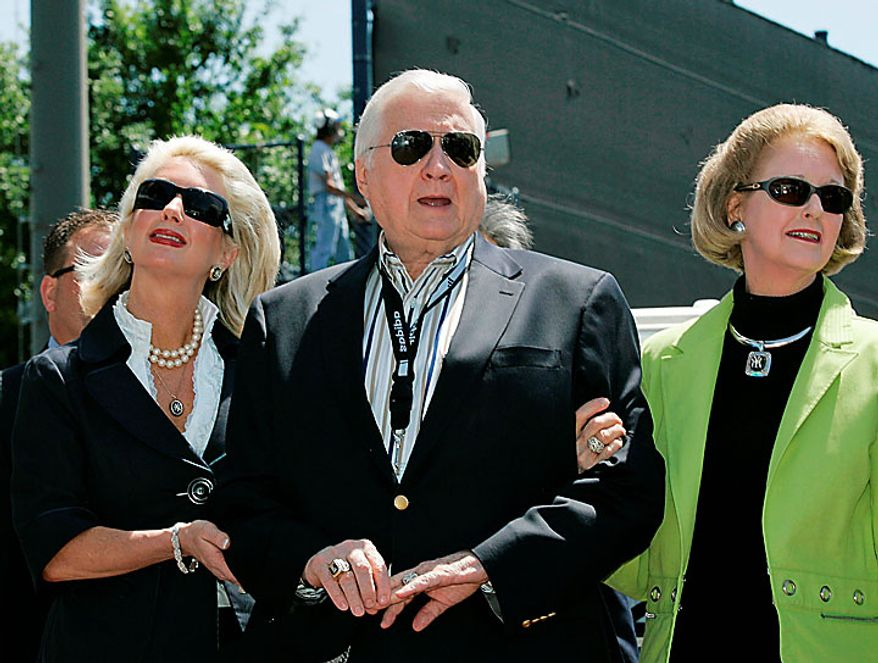 In this March 27, 2008, file photo, Jennifer Steinbrenner Swindal (left), New York Yankees senior vice president for new stadium public affairs, holds onto her father, Yankees principal owner George Steinbrenner (center), along with his wife, Joan, during a pregame ceremony renaming Legends Field as George M. Steinbrenner Field at a spring training baseball game in Tampa, Fla. A person close to George Steinbrenner says the Yankees owner died Tuesday morning, July 13, 2010. (AP Photo/Kathy Willens, File)