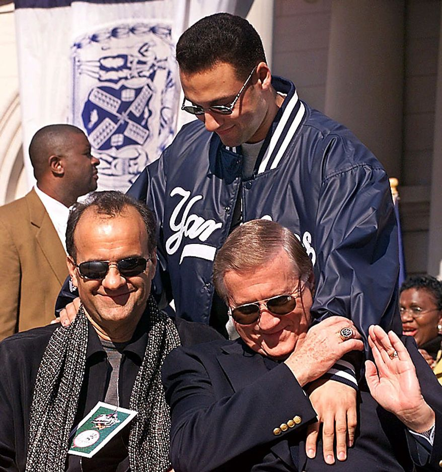 In this Oct. 29, 1999, file photo, New York Yankees shortstop Derek Jeter (rear) greets manager Joe Torre (left) and team owner George Steinbrenner at the start of the rally at City Hall honoring the 1999 World Series-winning New York Yankees in New York. A person close to George Steinbrenner says the Yankees owner died Tuesday, July 13, 2010. (AP Photo/Richard Drew, File)