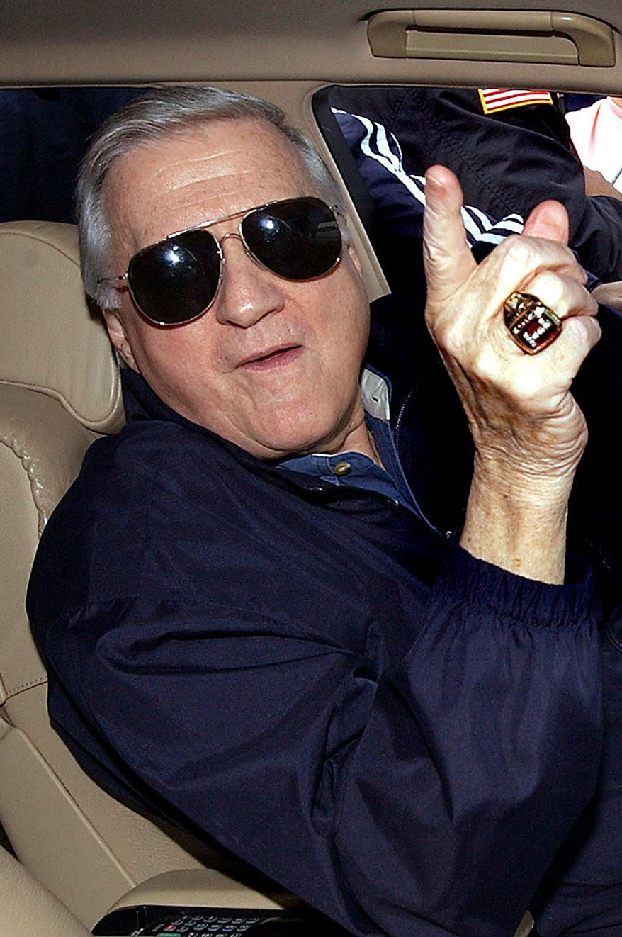 This Feb. 17, 2004, file photo shows New York Yankees owner George Steinbrenner gesturing outside the Yankees' minor league complex in Tampa, Fla. A person close to George Steinbrenner says the Yankees owner died Tuesday morning, July 13, 2010. (AP Photo/Chris O'Meara, File)