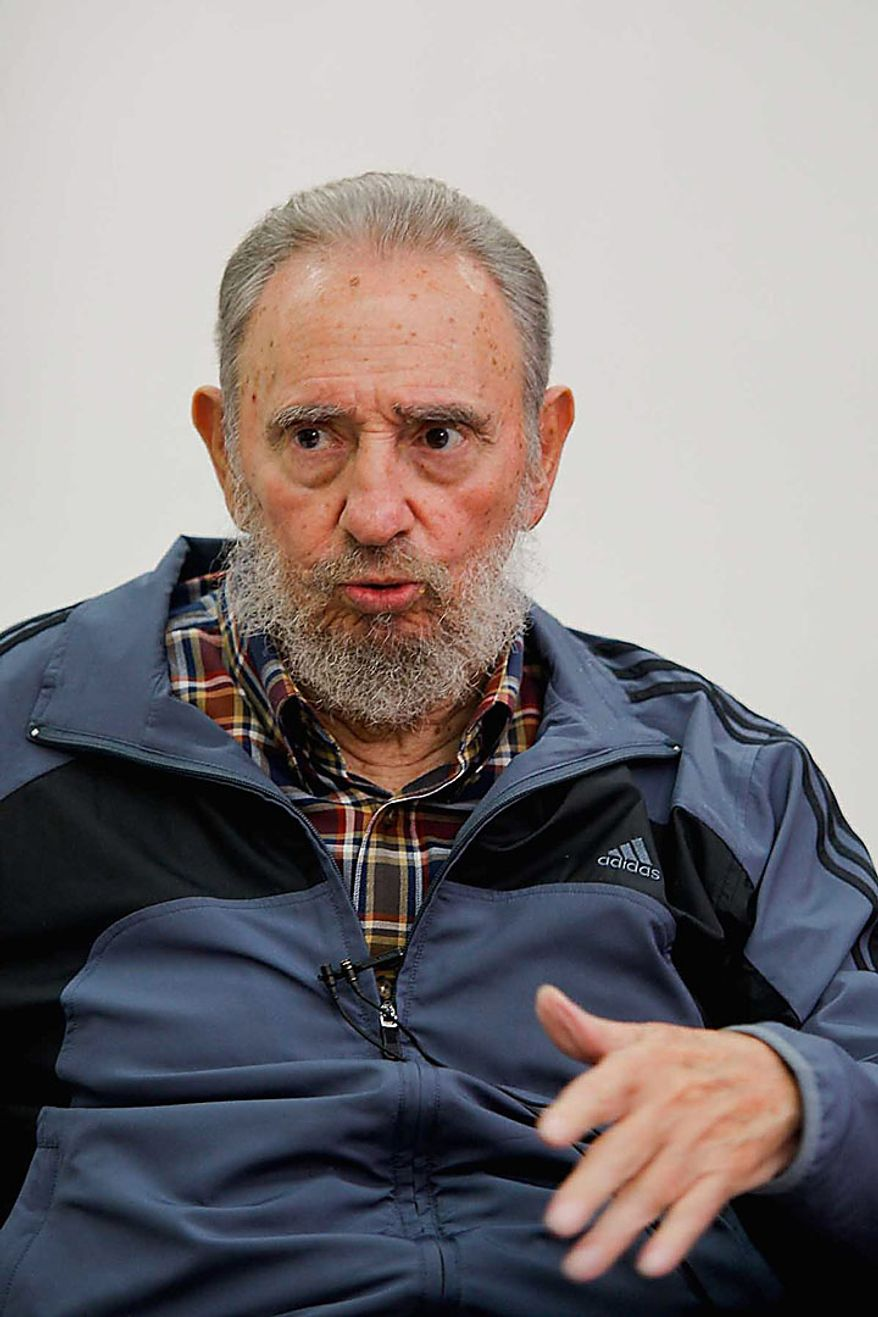 """In this photo released on Monday, July 12, 2010 by the state media Cubadebate website, Cuban leader Fidel Castro gestures during an interview with Cubavision in Havana, during the """"Mesa Redonda"""" or """"Round Table,"""" a daily Cuban talk show on current events. (AP Photo/Cubadebate, Alex Castro)"""