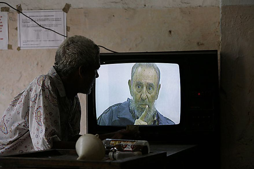 "A man watches Cuba's leader Fidel Castro on a TV set during an interview with Cubavision on its talk show ""Mesa Redonda"" or ""Round Table"" in Havana, Monday, July 12, 2010. Castro returned to the limelight Monday after years spent largely out of public view, discussing world events in a raspy voice in his most prominent television interview since falling seriously ill four years ago. (AP Photo/Franklin Reyes)"