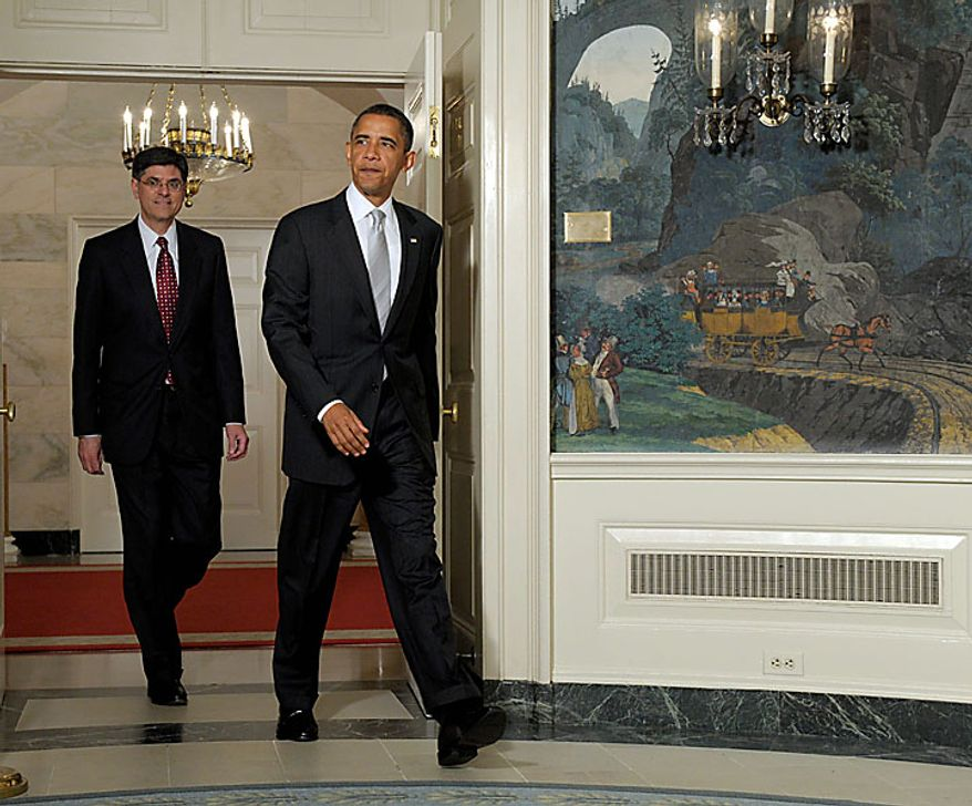 President Barack Obama walks into the Diplomatic Reception Room of the White House in Washington Tuesday, July 13, 2010, to announce he will nominate Jacob Lew, left, as the next budget director. (AP Photo/Susan Walsh)