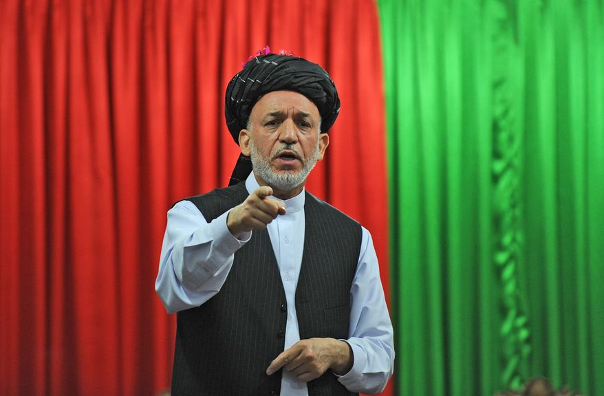 Afghan President Hamid Karzai speaks at a June meeting with tribal leaders in Kandahar city. Mr. Karzai and his national security team have endorsed a U.S.-supported plan to set up local police forces across the country overseen from Kabul. (Associated Press)