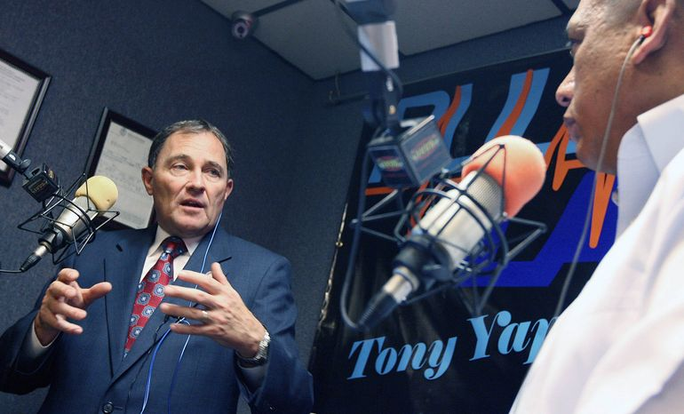 In this Thursday, July 1, 2010, photo, Utah Gov. Gary Herbert talks with local Salt Lake City radio host Tony Yapias about immigration and other issues facing Utah. (AP Photo /Deseret News, Brian Nicholson)