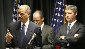 U.S. Attorney General Eric Holder speaks during a news conference announcing the indictment of six more New Orleans Police officers in the Danziger Bridge shooting and cover-up in the aftermath of Hurricane Katrina, Tuesday, July 13, 2010, at the Hale Boggs Federal Building in New Orleans. U.S. Attorney Jim Letten, is seen at right. (AP Photo/The Times-Picayune, Michael DeMocker)