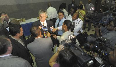 Cameras surround Amtrak CEO Joe Boardman as he and representatives from the Maryland Transit Administration met with riders to discuss recent incidents on the MARC lines on Wednesday, June 30, 2010, at Union Station in Washington. (AP Photo/The Baltimore Sun, Gene Sweeney Jr.)