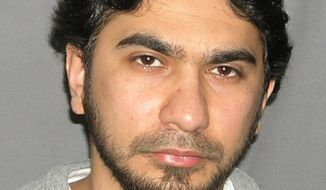 This undated file photo originally released by the U.S. Marshal's Service on May 19, 2010, shows Faisal Shahzad. The U.S. Justice Department announced on Thursday, June 17, 2010, that Shahzad, 30, has been indicted by a federal grand jury in New York on charges related to the failed May 1, 2010 car bombing in New York City's Times Square. (AP Photo/U.S. Marshals Service, File)