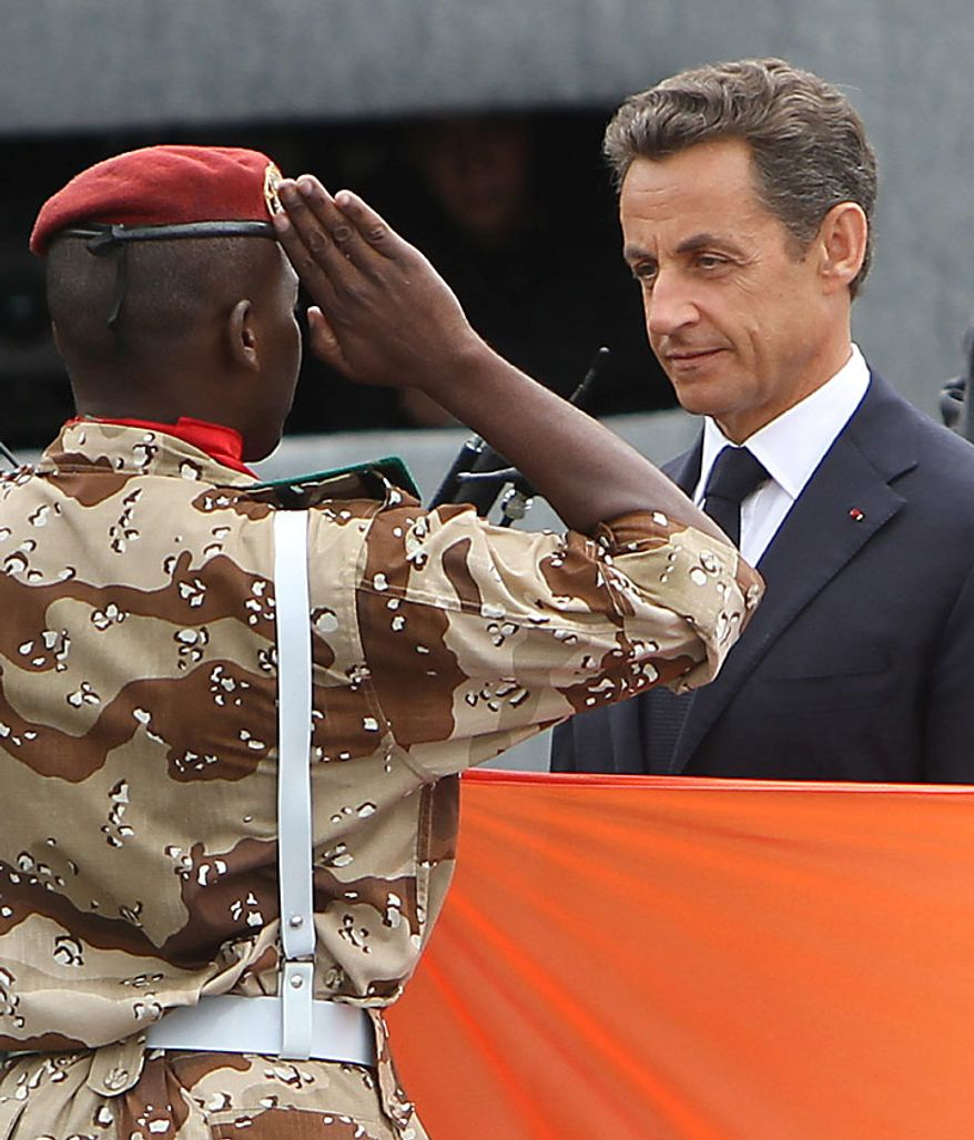 French President Nicolas Sarkozy (right) is saluted by an African soldier during the annual military parade at the Place de la Concorde during the Bastille Day celebrations in Paris on Wednesday, July 14, 2010. Leaders and soldiers from 13 former French colonies in Africa, celebrating five decades of independence, were invited to take part in this year's parade. (UPI/David Silpa)