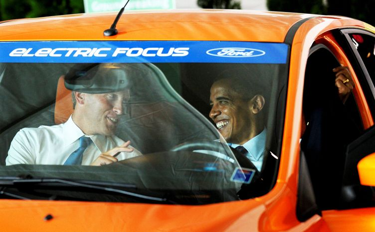 ASSOCIATED PRESS President Obama and Kurt Dykstra, mayor of Holland, Mich., sit in an electric Ford Focus on Thursday in Holland at the groundbreaking ceremony of Compact Power Inc., a battery plant and a subsidiary of LG Chem Ltd.