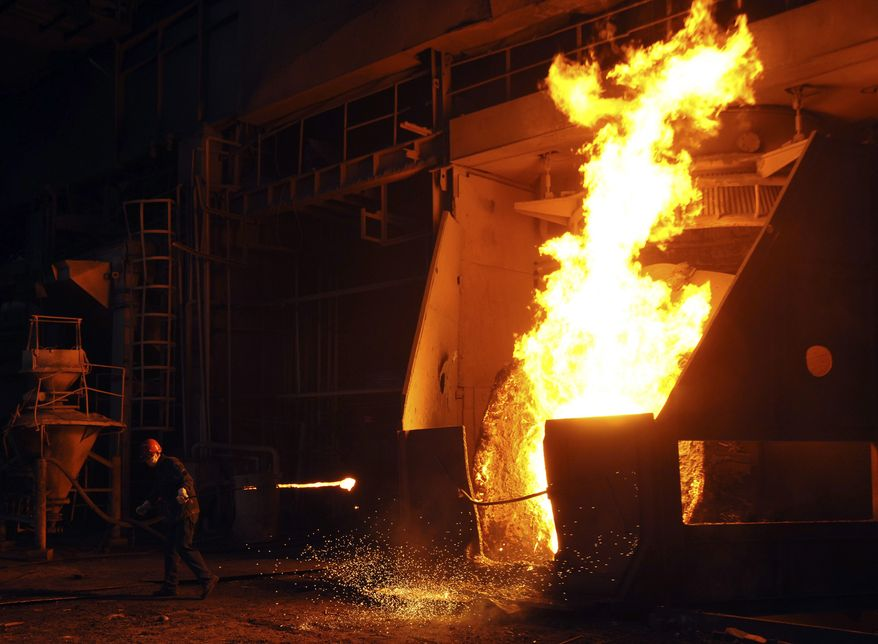 In this photo taken Wednesday July 7, 2010, a worker labors at a steel plant in Hefei in central China's Anhui province. China's rapid growth is slowing as the impact of its massive stimulus eases and Beijing clamps down on a credit boom. The world's third-largest economy expanded by 10.3 percent in the second quarter over a year earlier, down from the first quarter's explosive 11.9 percent growth, the National Bureau of Statistics said on Thursday, July 15, 2010. (AP Photo)