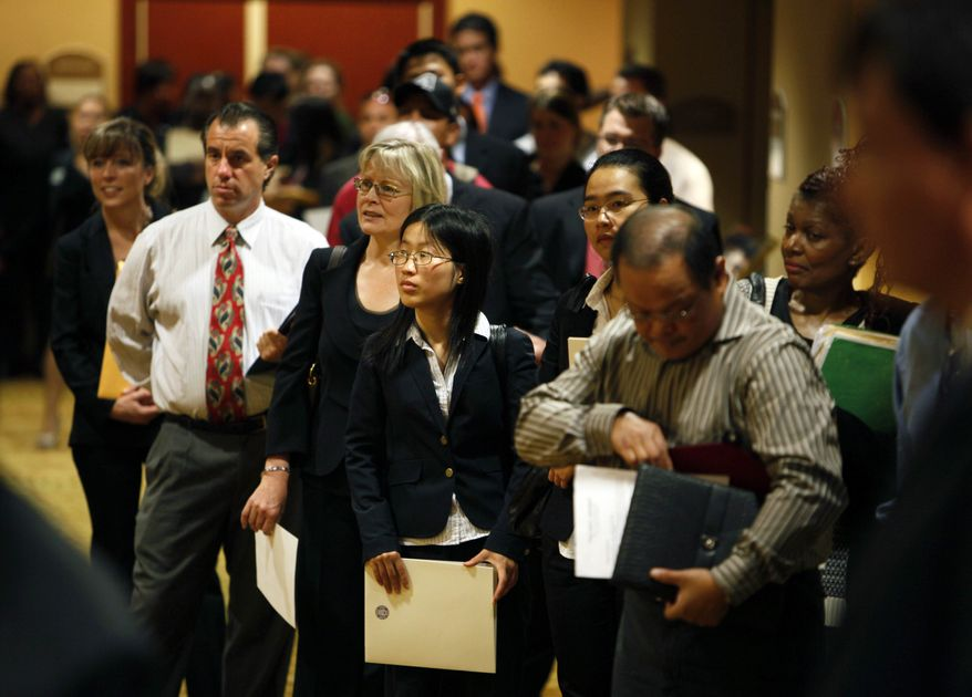 ** FILE ** In this June 28, 2010, photo, job seekers wait in line to attend at a National Career Fair in San Francisco. New applications for unemployment benefits fell sharply last week as General Motors and other manufacturers skipped their usual summer shutdowns. (AP Photo/Eric Risberg)