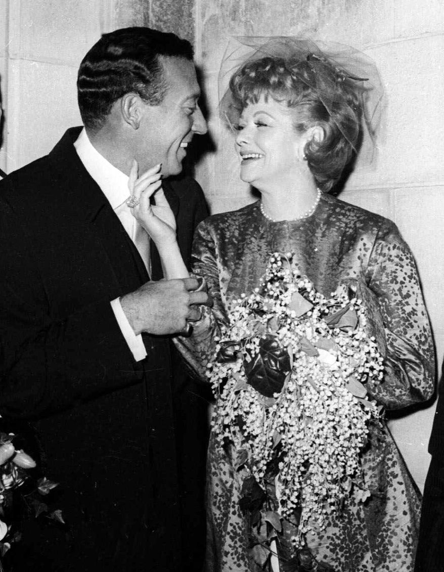 ** FILE ** In this Nov. 20, 1961 file photo, Gary Morton, left, and Lucille Ball pose after their wedding at the Marble Collegiate Church in New York. (AP Photo, file)