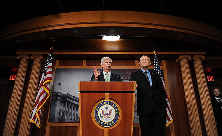 Senate Majority Leader Harry Reid, D-NV, and Sen. Christopher Dodd, D-CT, hold a news conference following passage of the financial reform bill on Capitol Hill in Washington on July 15, 2010.  UPI/Roger L. Wollenberg