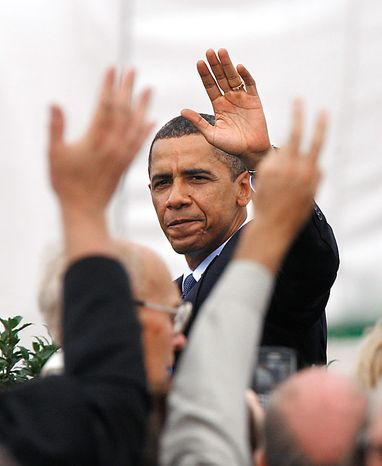 President Barack Obama waves to the crowd after attending a groundbreaking ceremony for the LG Chem plant that will manufacture advanced batteries for Chevrolet and Ford electric cars, Thursday, July 15, 2010, in Holland, Mich. (AP Photo/Carlos Osorio)