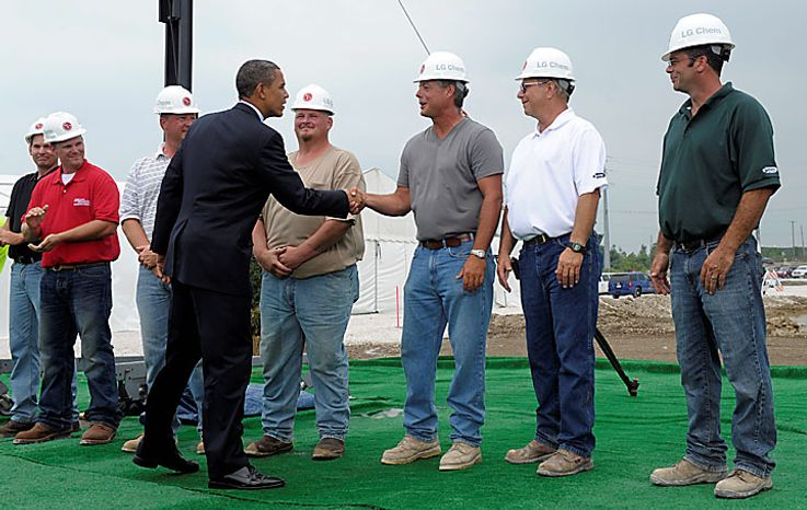President Barack Obama greets workers as he walks to the stage to deliver remarks, Thursday, July  15, 2010, at the groundbreaking ceremony at Compact Power, Inc., a subsidary of LG Chem Ltd., a battery plant in Holland, Mich. (AP Photo/Susan Walsh)