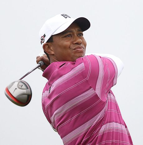 American Tiger Woods drives the ball on the 4th hole on the first day of the Open championship in St. Andrews, Scotland on July 15, 2010. (UPI/Hugo Philpott)