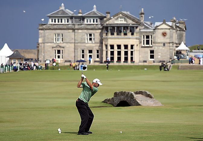 Australia's Cameron Percy hits off the 18th tee during the first round of the British Open Golf Championship on the Old Course at St. Andrews, Scotland, Thursday, July 15, 2010. (AP Photo/Peter Morrison)