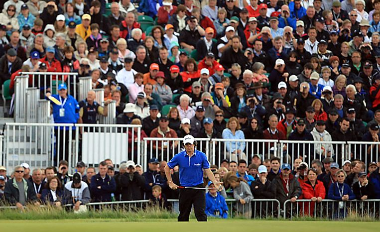 Northern Ireland's Rory McIlroy prepares to putt on the 16th green during the first round of the British Open Golf Championship on the Old Course at St. Andrews, Scotland, Thursday, July 15, 2010. (AP Photo/Tim Hales)