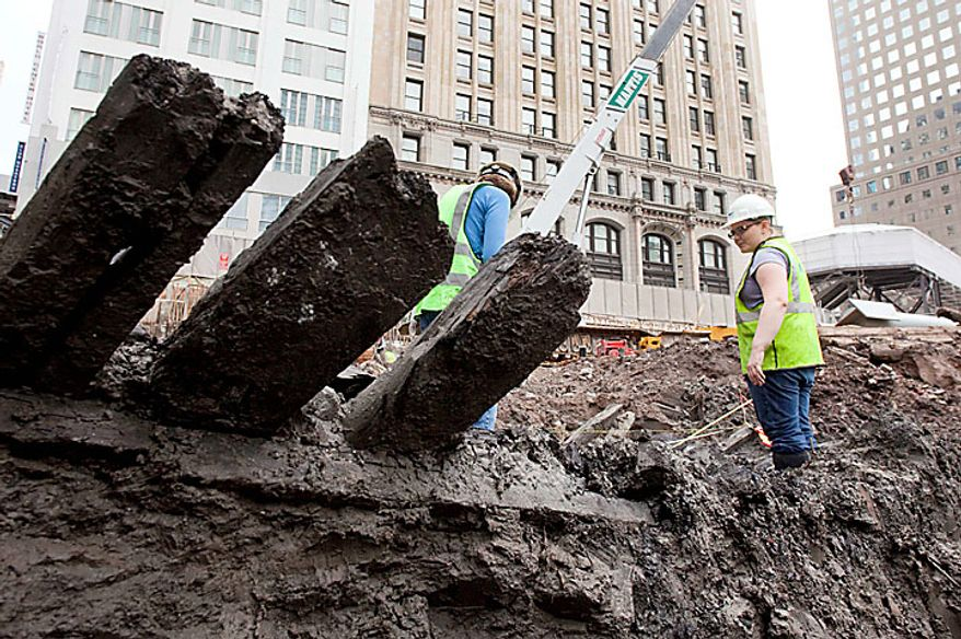Planks stick out of the mud of a 32-foot-long (9.75 meters) 18th century boat at the World Trade Center site on  Thursday, July 15, 2010 in New York. (AP Photo/Mark Lennihan)
