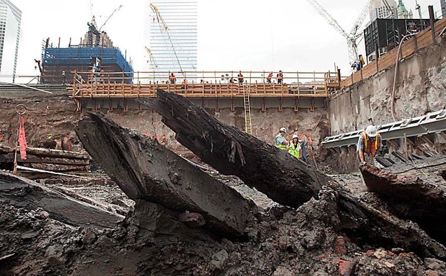 The curved ribs of a wood hull of a 32-foot-long (9.75 meters) 18th century boat poke up from the mud at the World Trade Center site on Thursday, July 15, 2010 in New York. (AP Photo/Mark Lennihan)