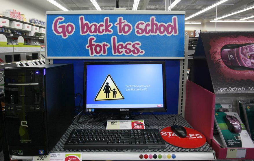 In this photograph take July 8, 2010, a computer for less is dispalyed at a Staples in Menlo Park, Calif., Thursday, July 8, 2010. Consumer prices fell for the third straight month, providing some bargains to American shoppers.(AP Photo/Paul Sakuma)