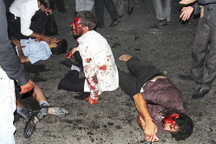 This picture released by  Iran's official Islamic Republic News Agency shows the victims of a bomb blast in the city of Zahedan, 940 miles southeast of the capital Tehran Thursday, July 15, 2010. Twin bombings killed more than 20 people outside a mosque in southeastern Iran on Thursday -- including members of the powerful Revolutionary Guard -- in attacks that came less than a month after Iran hanged the leader of a militant insurgent group in the region. (AP Photo/Islamic Republic News Agency, IRNA)