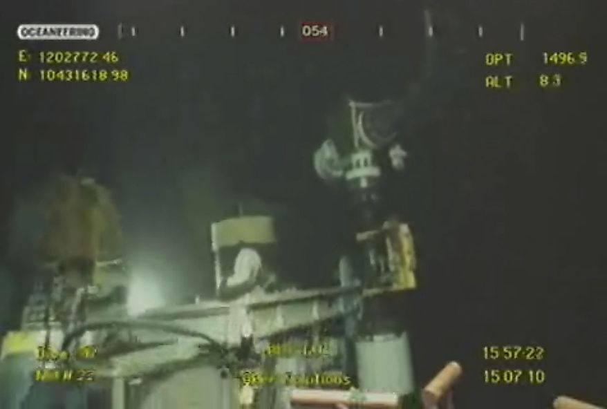 This image taken from video provided by BP PLC at 15:57 CDT, shows that oil has stopped flowing from the new 75-ton cap atop the site of the Deepwater Horizon oil spill in the Gulf of Mexico Thursday, July 15, 2010. BP finally choked off the flow of oil into the Gulf of Mexico on Thursday -- 85 days and up to 184 million gallons after the crisis unfolded -- then began a tense 48 hours of watching to see whether the capped-off well would hold or blow a new leak. Engineers will monitor pressure gauges and watch for signs of leaks elsewhere in the well. (AP Photo/BP PLC)