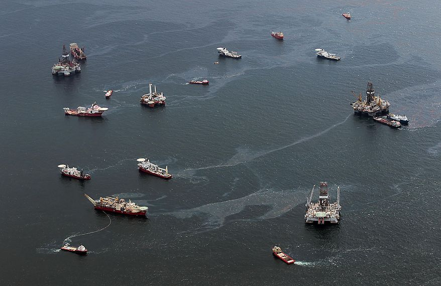 Drilling rigs and workboats operate at the site of the Deepwater Horizon incident in the Gulf of Mexico Friday, July 16, 2010. The wellhead has been capped and BP is continuing to test the integrity of the well before resuming production. (AP Photo/Dave Martin)