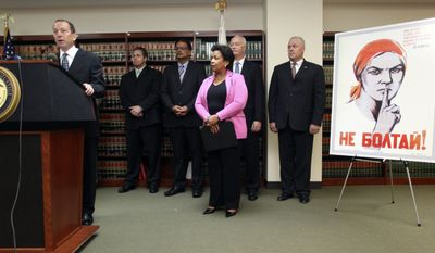 "Assistant Attorney General Lanny Breuer, left, speaks to the media as Loretta Lynch, center, U.S. Attorney for the Eastern District of New York, and other law enforcement officials announce charges against doctors, health care company owners, executives and others in a case of alleged false medicare billing at a news conference in the U.S. Attorney's office in the Brooklyn borough of New York, Friday, July 16, 2010. The poster at right, which says in Russian ""Do Not Gossip,"" was, allegedly, in the back room of a doctor's office where patients were being bribed for their cooperation in the scheme. (AP Photo/Robert Mecea)"