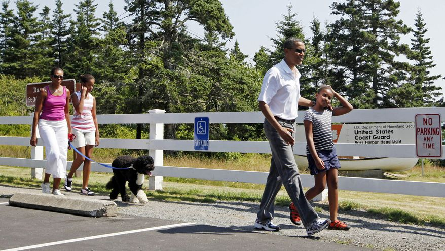 President Obama, first lady Michelle Obama (left), daughters Malia and Sasha (right), and dog Bo arrive to visit Bass Harbor Head lighthouse in Bar Harbor, Maine, on Saturday, July 17, 2010. (AP Photo/Charles Dharapak)