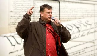 "Tea Party Express leader Mark Williams addresses a crowd March 30 in Salt Lake City. A spokesman for the National Tea Party Federation on Sunday said the organization has expelled the Tea Party Express from its ranks for refusing to oust Mr. Williams after he posted a blog that satirized the NAACP and referred to its president, Benjamin Jealous, as ""Tom's nephew and NAACP head colored person."""