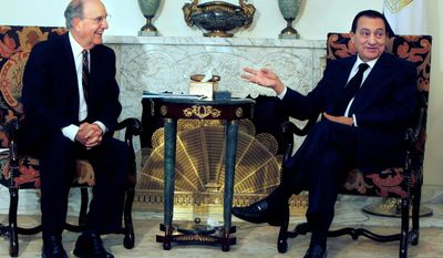 Egyptian President Hosni Mubarak (right) meets with George J. Mitchell, U.S. envoy for the Middle East, at the Presidential palace in Cairo. The talks come within the framework of efforts aimed at reviving direct negotiations between Israel and the Palestinians.
