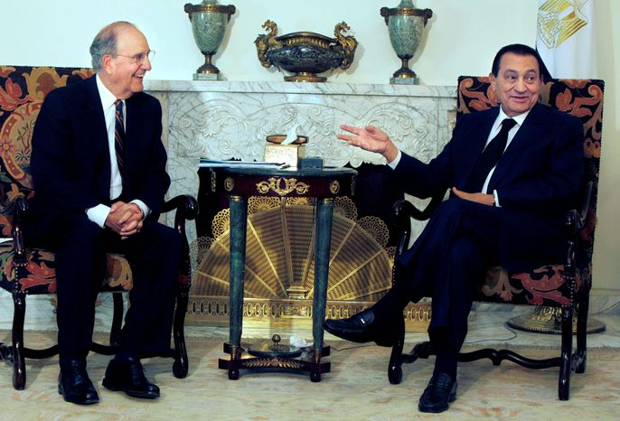 Egyptian President Hosni Mubarak (right) meets with George J. Mitchell, U.S. envoy for the Middle East, at the Presidential palace in Cairo. The talks come within the framework of efforts aimed at reviving direct negotiations between Isr