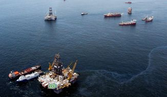 ** FILE ** Vessels assisting BP and the Coast Guard in the capping of the Deepwater Horizon oil wellhead were hard at work on the Gulf of Mexico near the coast of Louisiana on July 18, 2010. (AP Photo)