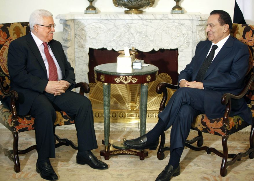 Egyptian President Hosni Mubarak (right) meets with Palestinian Authority President Mahmoud Abbas at the Presidential Palace in Cairo on Sunday, July 18, 2010. Talks come within the framework of efforts aimed at reviving direct negotiations between Israel and Palestinians. (AP Photo/Amr Nabil)