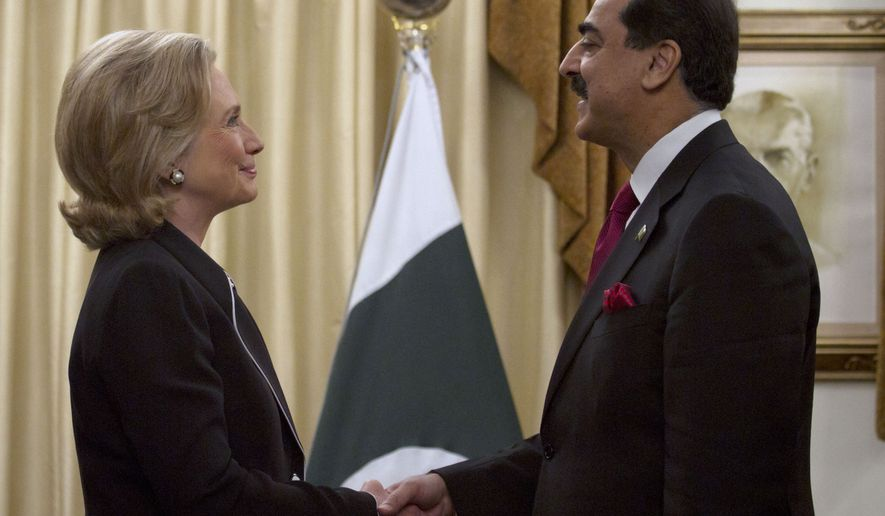 Secretary of State Hillary Rodham Clinton shakes hand with Pakistani Prime Minister Yousuf Raza Gilani before their meeting in Islamabad, Pakistan, on Sunday, July 18, 2010. Mrs. Clinton started a South Asia tour aimed at refining the goals of the nearly 9-year-old war in Afghanistan and pushing neighboring nations to work together in the fight against al Qaeda and Taliban extremists. (AP Photo/Anjum Naveed)