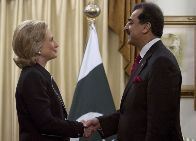Secretary of State Hillary Rodham Clinton shakes hand with Pakistani Prime Minister Yousuf Raza Gilani before their meeting in Islamabad, Pakistan, on Sunday, July 18, 2010. Mrs. Clinton started a South Asia tour aimed at refining the goals of the nearly 9-year-old war in Afghanistan and pushi
