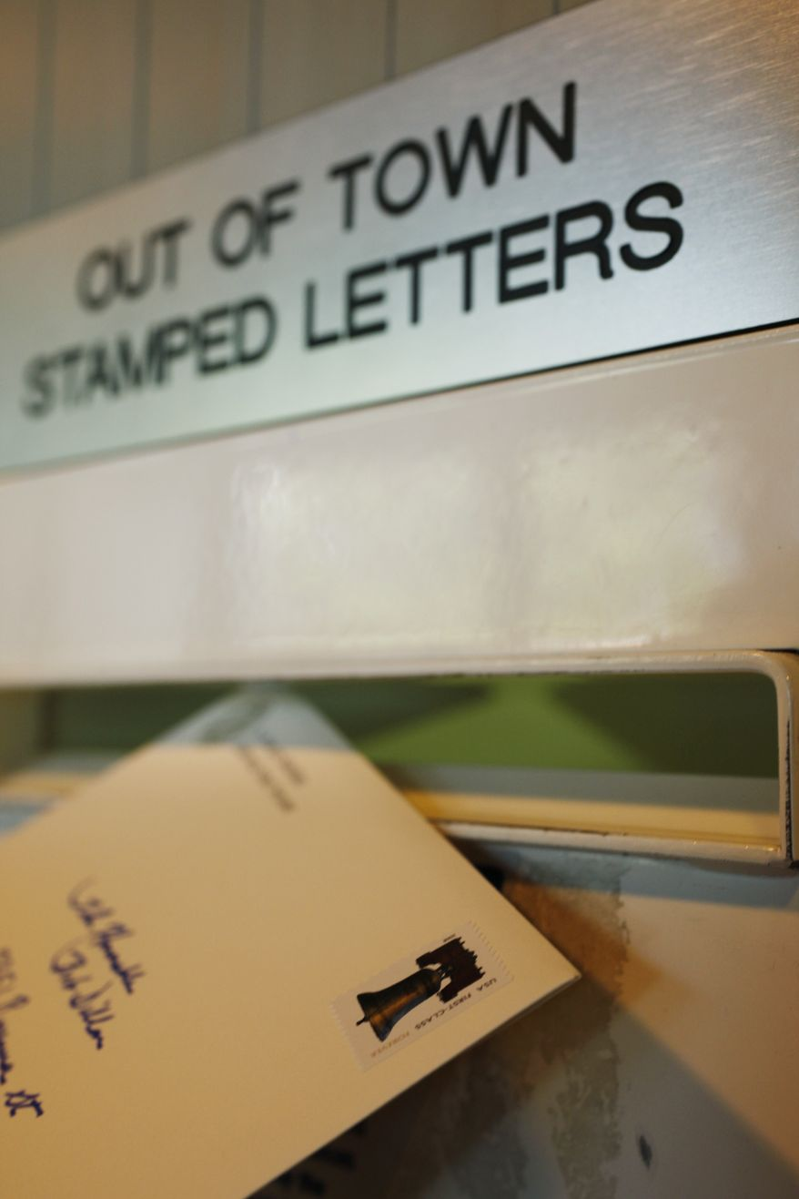 **FILE** In this photo from May 11, 2009, a letter is mailed from a post office in Palo Alto, Calif. (Associated Press)