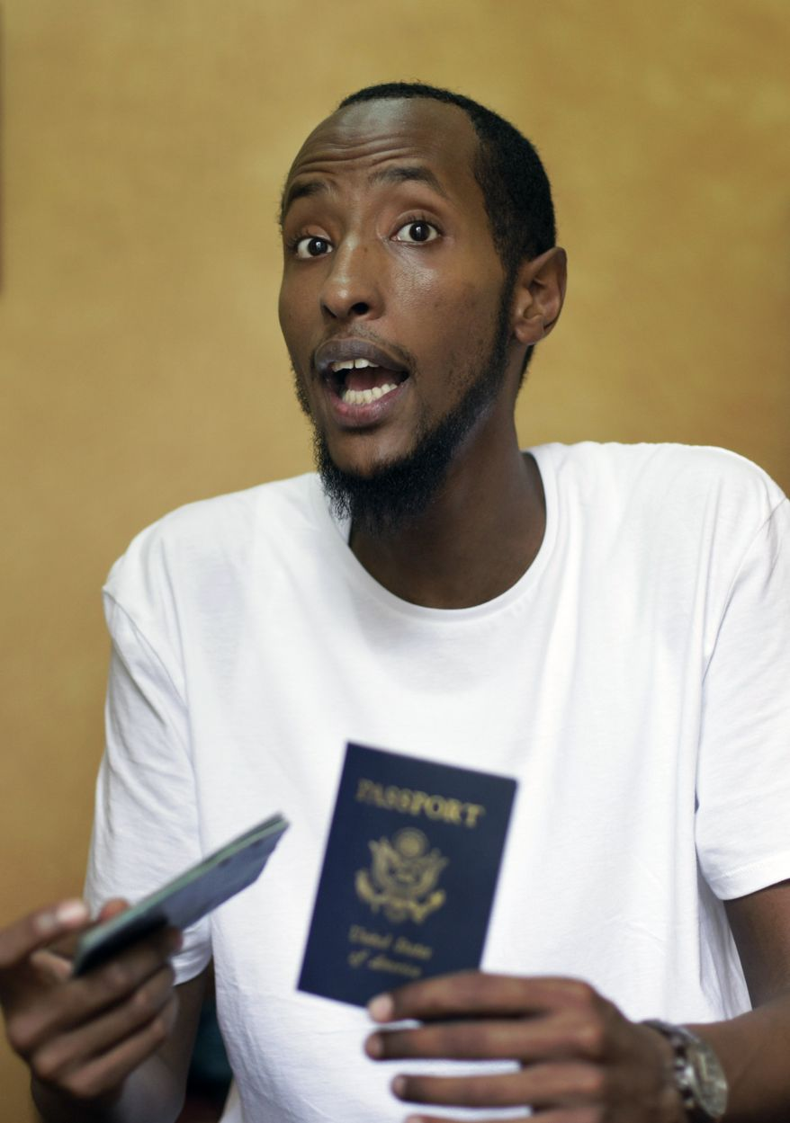 ** FILE ** Yahya Wehelie of Burke, Va., displays his U.S. passport in Cairo on June 16, 2010. Mr. Wehelie, whose travels to Yemen landed him on the U.S. no-fly list and left him stuck in the Middle East for months, arrived in New York on Saturday. (AP Photo/Ben Curtis, File)