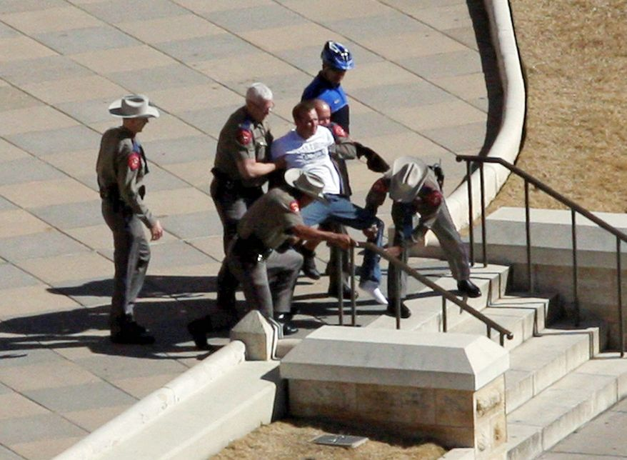 ASSOCIATED PRESS PHOTOGRAPHS Authorities detain a man suspected of firing a gun outside the main entrance to the Texas Capitol on Jan. 21. No one was harmed, but metal detectors were installed in May.
