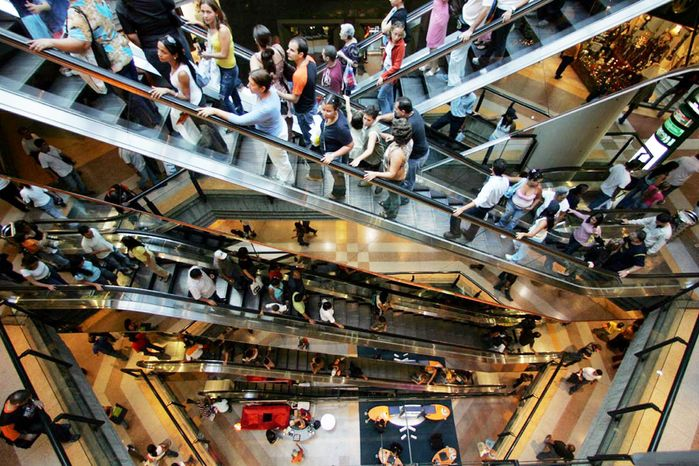 Shoppers throng to a popular mall in Caracas in November 2006. Consumerism remains strong, creating resistance to socialism as Mr. Chavez looks to September's congressional elections.