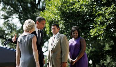 President Obama leaves the Rose Garden on Monday after saying Republicans are wrong to withhold more unemployment benefits from people looking for work such as, from left: Leslie Macko, from Charlottesville, Va., Jim Chukalas, from Fredon Township, N.J., and Denise Gibson, from Brooklyn, N.Y. They were invited to appear with the president as a way to humanize his plea for another extension of jobless benefits. (Associated Press)