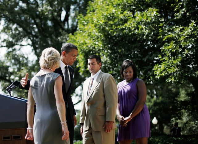 President Obama leaves the Rose Garden on Monday after saying Republicans are wrong to withhold more unemployment benefits from people looking for work such as, from left: Leslie Macko, from Charlottesville, Va., Jim Chukalas, from Fredon Township, N.J., and Denise Gibson, from Brooklyn, N.Y. They were invited to appear with the presi