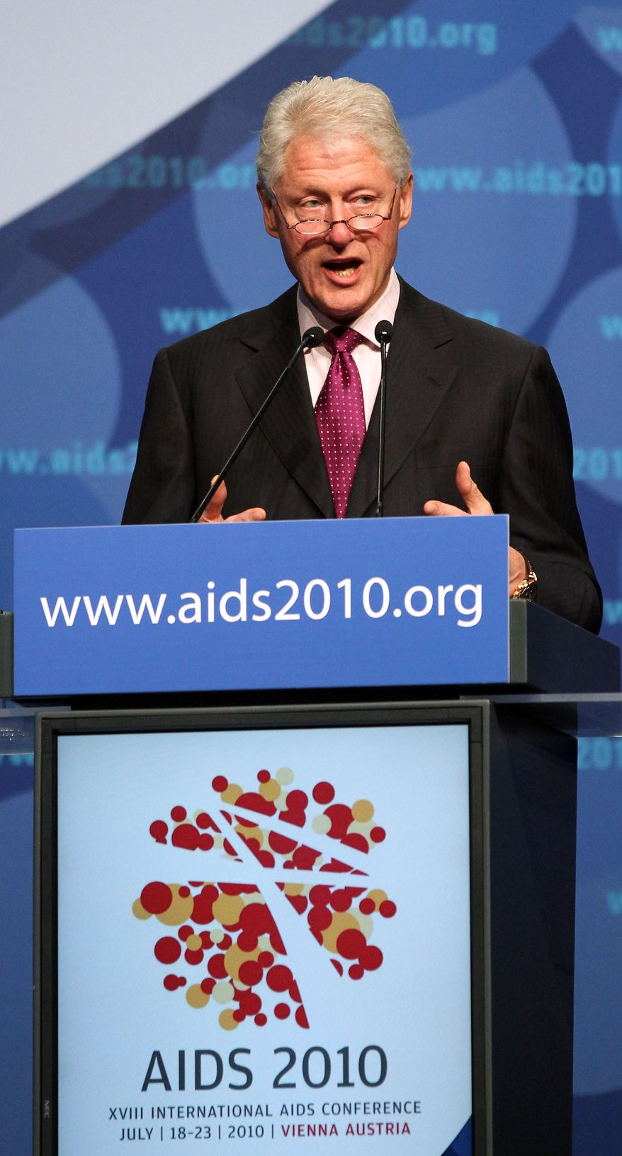 Former President Bill Clinton addresses delegates at the International AIDS Conference in Vienna, Austria, on Monday, July 19, 2010. (AP Photo/Ronald Zak)