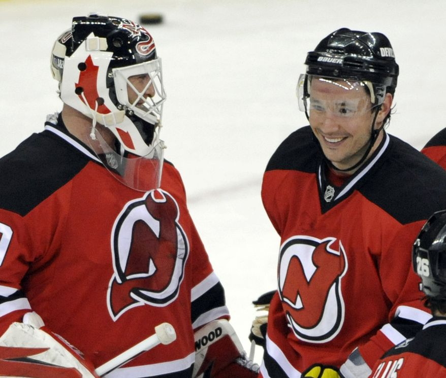** FILE ** This April 11, 2010, file photo shows New Jersey Devils goaltender Martin Brodeur, left, and Ilya Kovalchuk smiling after the Devils beat the Buffalo Sabres 2-1 in an NHL hockey game in Newark, N.J. Kovalchuk is staying with the New Jersey Devils. (AP Photo/Bill Kostroun)