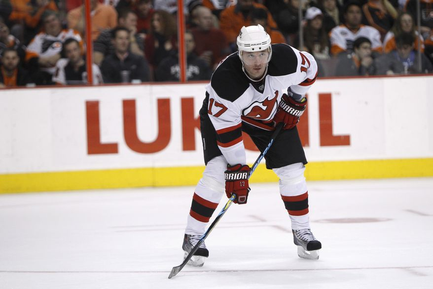 ASSOCIATED PRESS FILE - In this March 28, 2010, file photo, New Jersey Devils' Ilya Kovalchuk, of Russia, is shown during an NHL hockey game against the Philadelphia Flyers, in Philadelphia. Kovalchuk is staying with the New Jersey Devils. The team said on Monday, July 19, 2010, that the biggest prize of the NHL free agent market agreed to a new contract, ending weeks of speculation where the high-scoring forward would play next season.