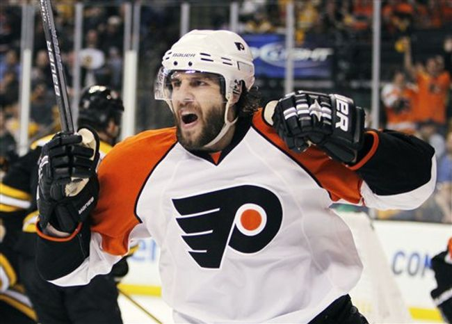 FILE - This May 14, 2010, file photo shows Philadelphia Flyers' Simon Gagne celebrating his go-ahead goal in the third period of Game 7 of a second-round NHL playoff hockey series against the Boston Bruins, in Boston. (AP Photo/Michael Dwyer, File)