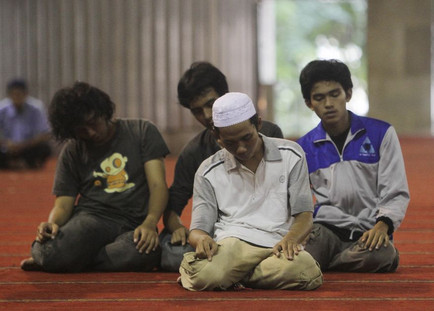 Indonesian Muslim men pray at Istiqlal Mosque in Jakarta, Indonesia, Monday, July 19, 2010. People in the world's most populous Muslim nation have been facing Africa, not Mecca, while praying. Indonesia's highest Islamic body acknowledged Monday it made a mistake when issuing an edict in March saying the holy city in Saudi Arabia was to the country's west. It has since asked followers to shift direction slightly northward during their daily prayers. (AP Photo/Irwin Fedriansyah)