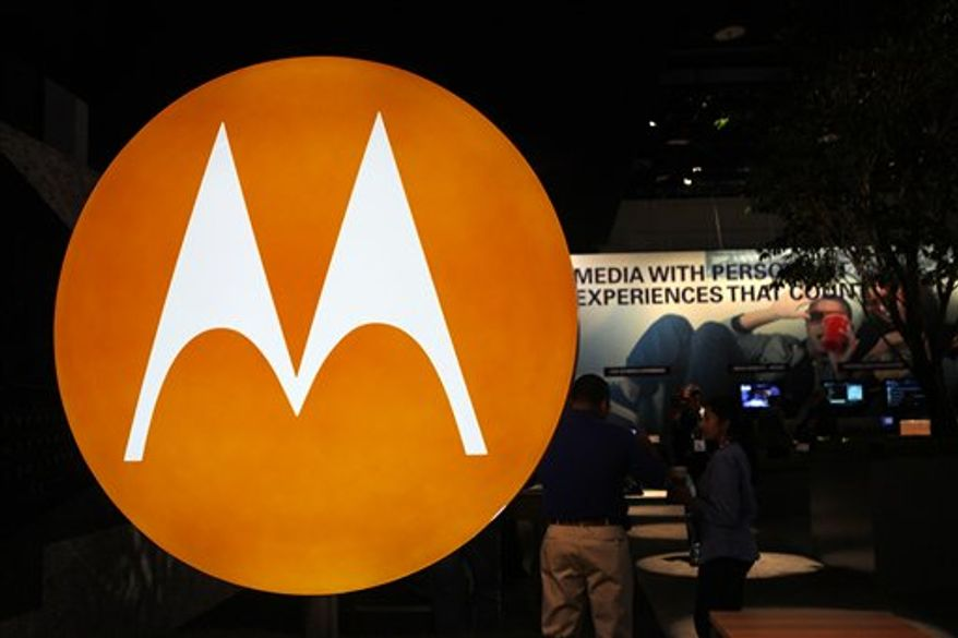 FILE - In this file photo made Jan. 9, 2010, the Motorola logo is seen at the company's exhibit at the Consumer Electronics Show in Las Vegas. Motorola Inc. said Monday, July 19, 2010, that it is selling most of its wireless network division to Nokia Siemens Networks, a Finnish-German joint venture, for $1.2 billion as part of a planned breakup of the company. (AP Photo/Paul Sakuma, file)